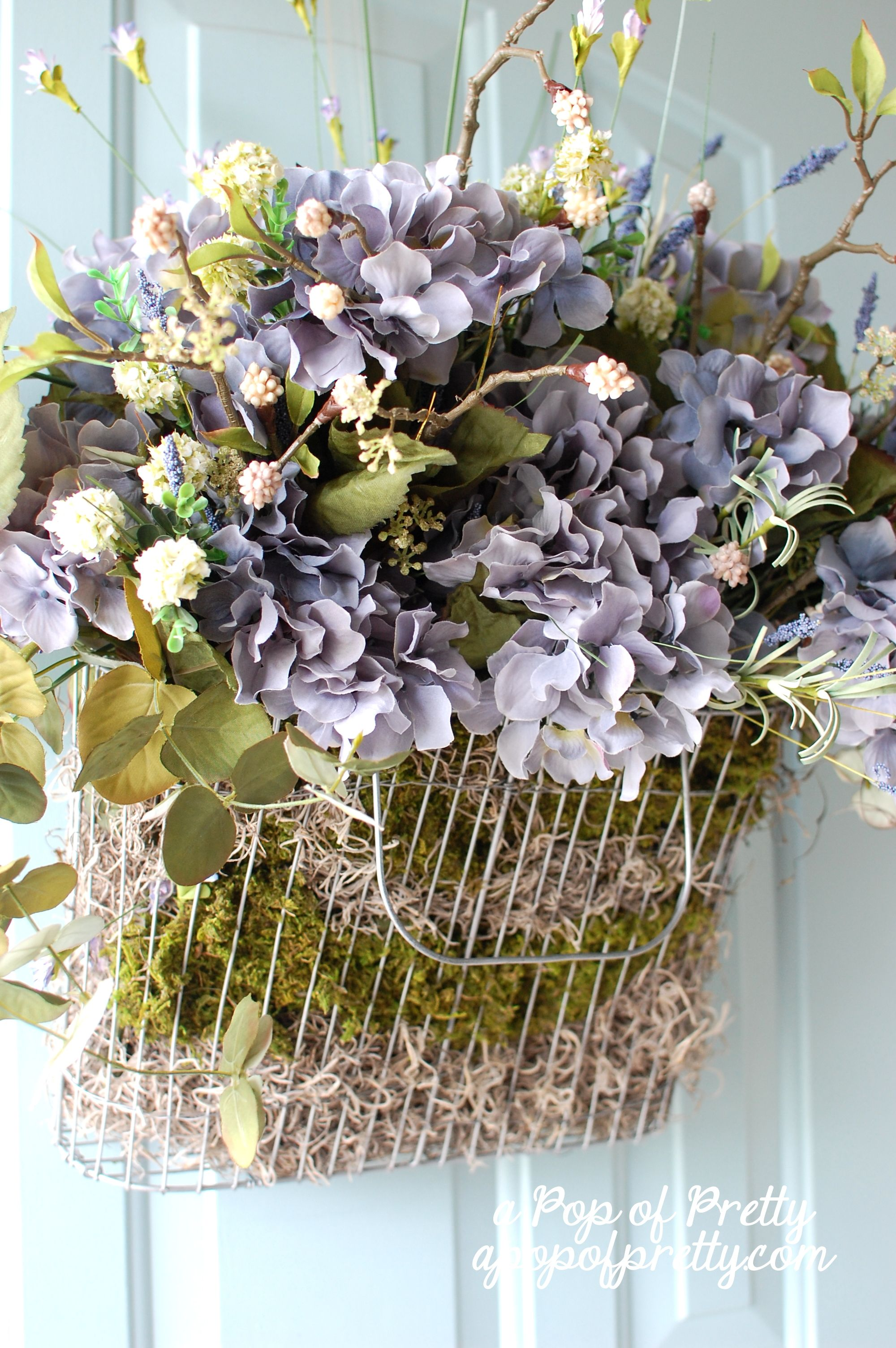 Summer door decor idea. Tired of wreaths? Fill a wire basket with moss and & Tired of wreaths? Hang a basket. Easy summer DIY door decor idea ...