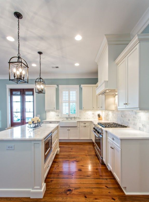 Raindrop Blue Kitchen With White Cabinets And Lantern Chandeliers