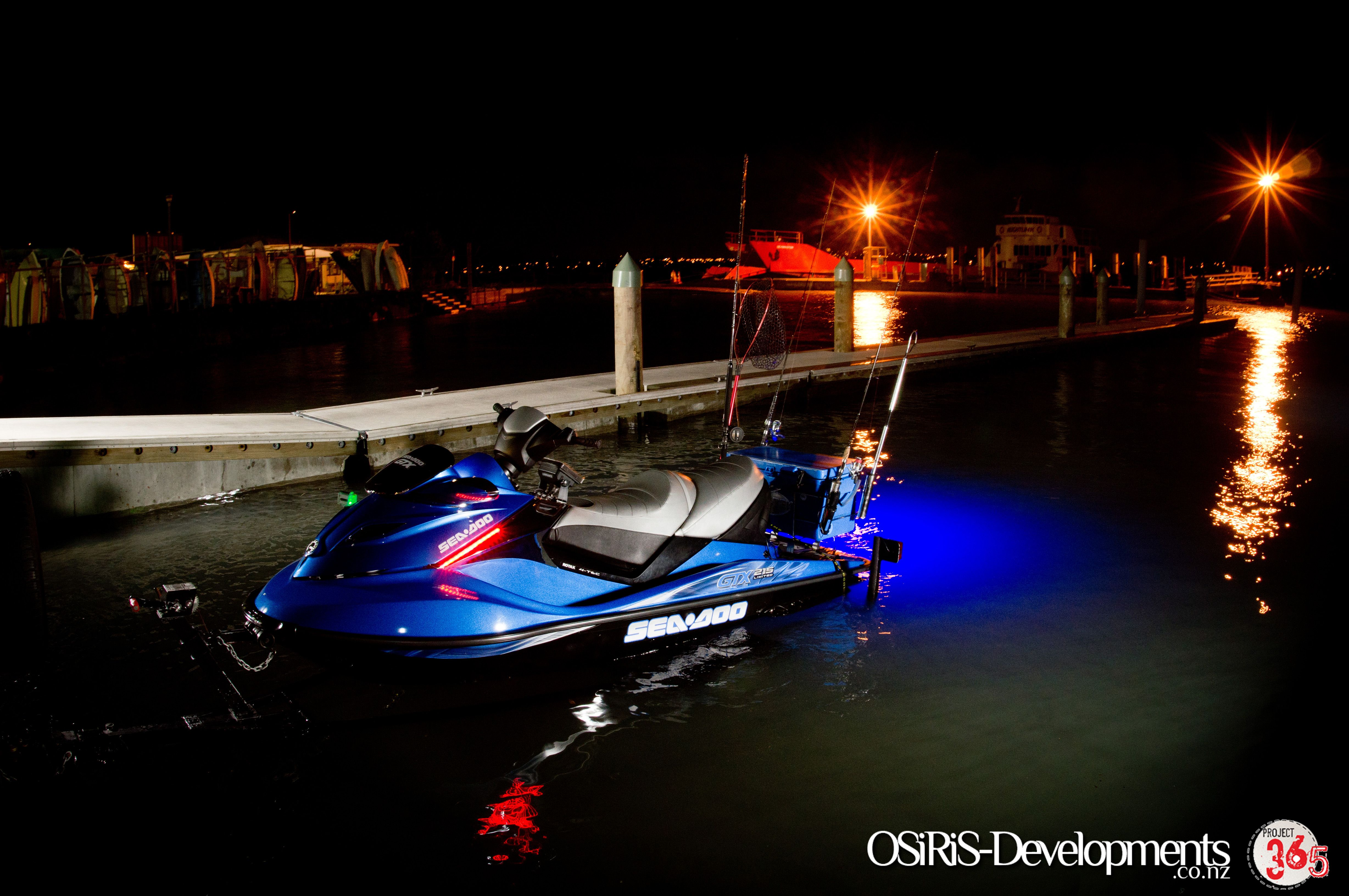 Blue led rib light in the drain bung of a jetski kitted for Fishing boat lights