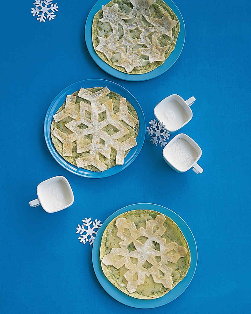 Snowflake Quesadillas Game Day Recipes   Martha Stewart Living - Take a simple cheese quesadilla to the next level by cutting the top tortilla into an intricate snowflake.