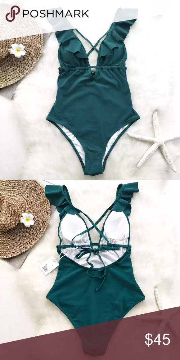 986bfd8890 Teal Ruffle Deep V One Piece Swimsuit This swimsuit will have passers-by  staring in appreciation as you do your thing on the beach with your family  and ...