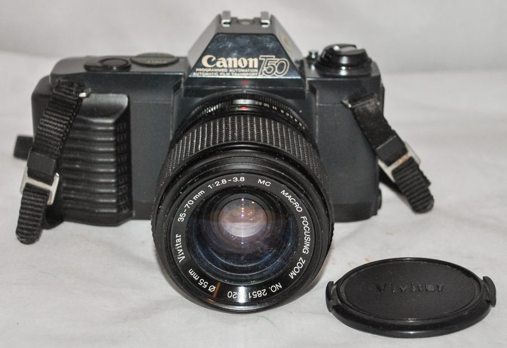 Canon T50 Slr 35mm Camera With Vivitar 35 70mm F 2 8 3 8 Mc Focusing Zoom Lens Zoom Lens 35mm Camera Camera Photography