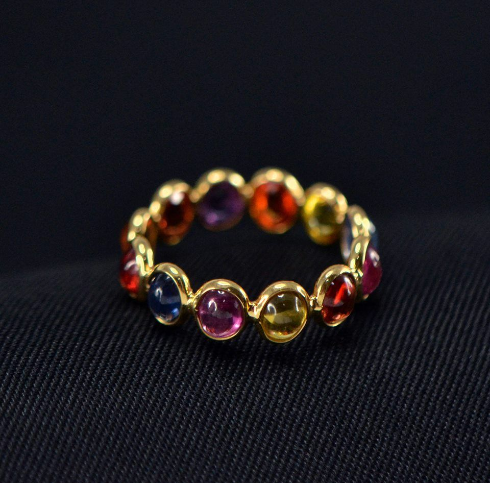 Multi color stone ring crafted with 18k yellow goldkindly email to