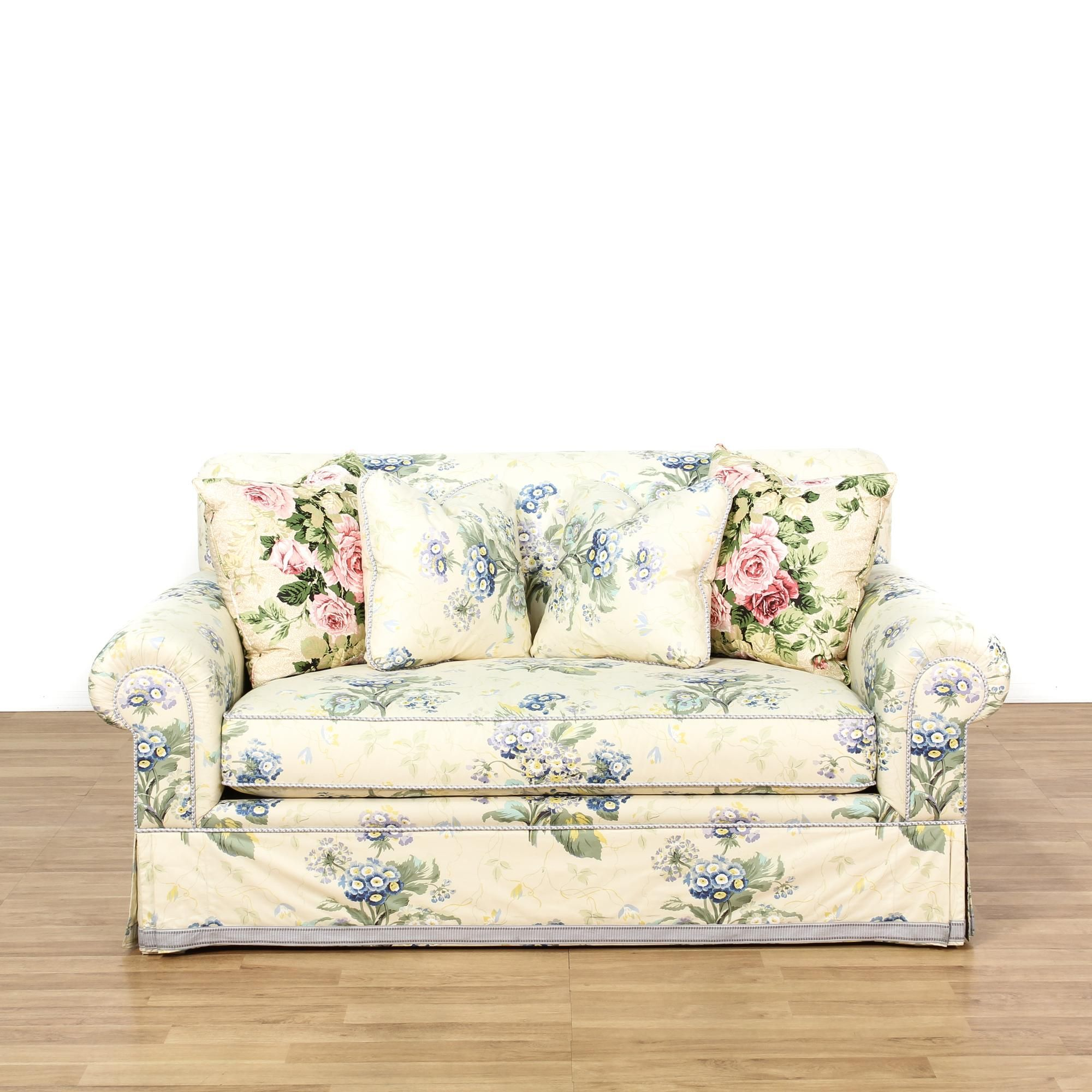 this loveseat is upholstered in a blue floral pattern this cottage chic style sofa has rolled end arms comfortable c love seat cottage chic vintage furniture
