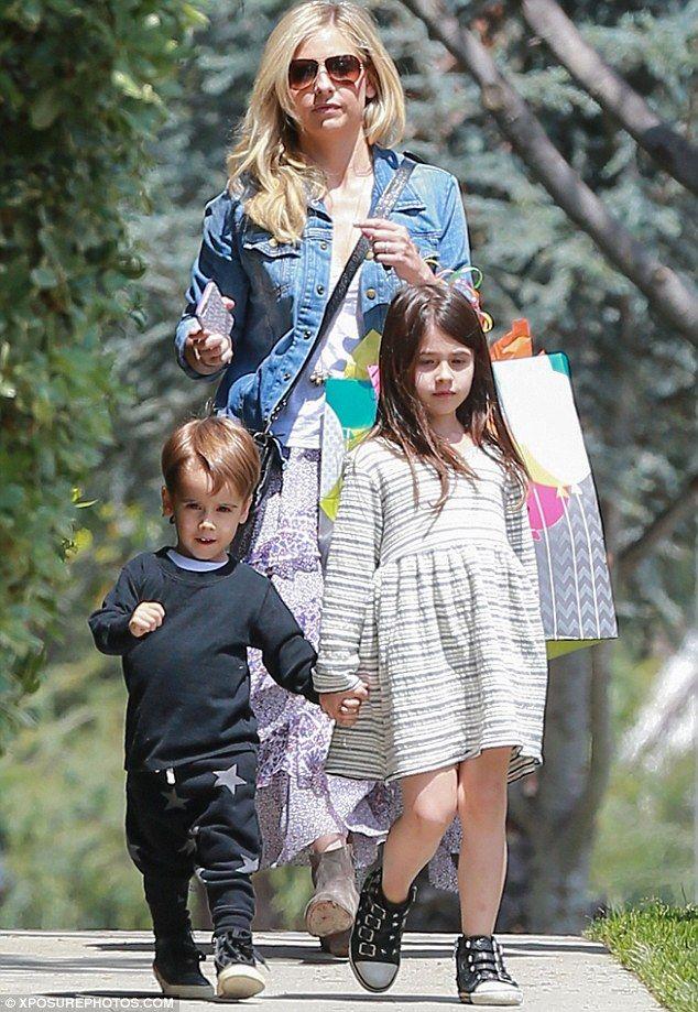 Sarah Michelle Gellar trails behind two children Rocky and ...