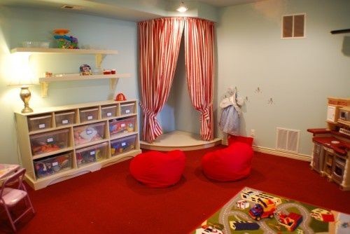 Playful playroom with mini stage. Need an art corner for my 2 artists, but the other 2 need that stage!