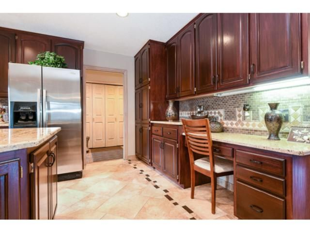 BEAUTIFUL dark wood kitchen complete with granite counter tops!