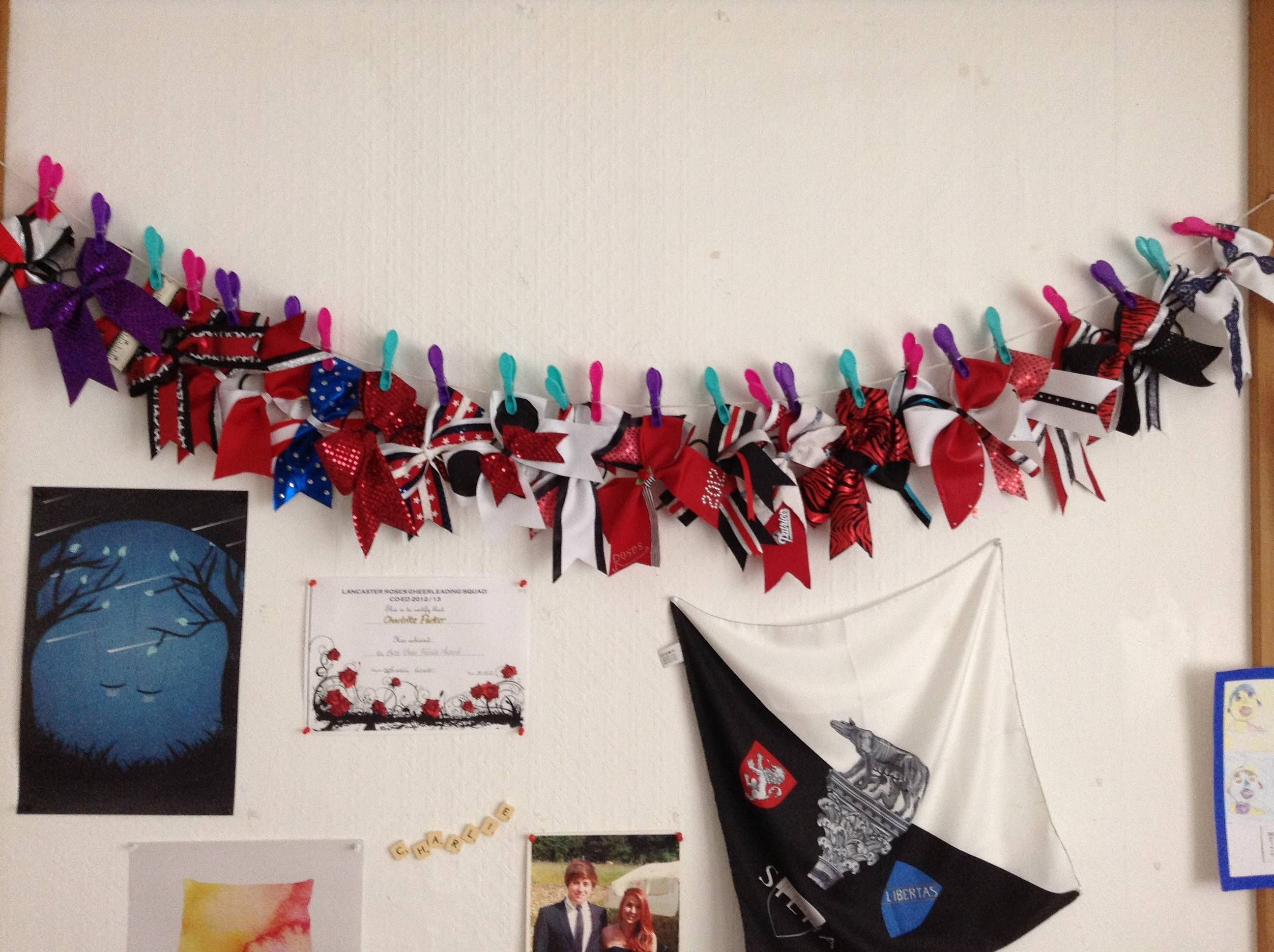 Cheer bow holder for cheer bows and hair bows cheer bow hanger - Easy Way To Organize Cheer Bows A Piece Of String And Some Clips Is All You