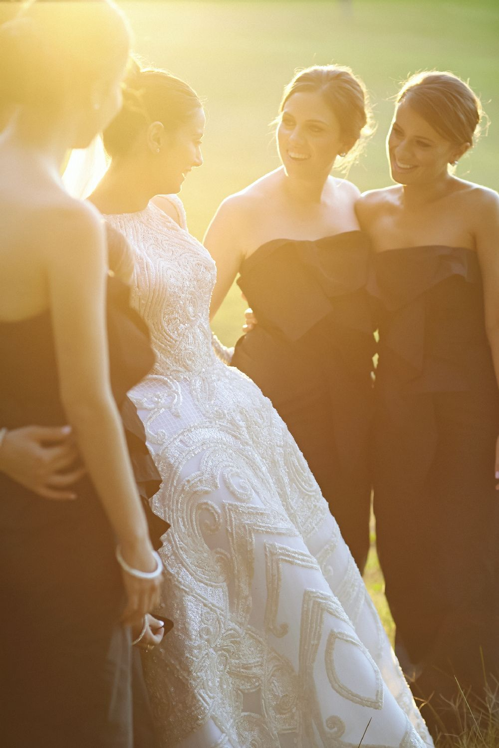 Bride in J'Aton wedding gown + navy blue bridesmaids + white bouquet | itakeyou.co.uk