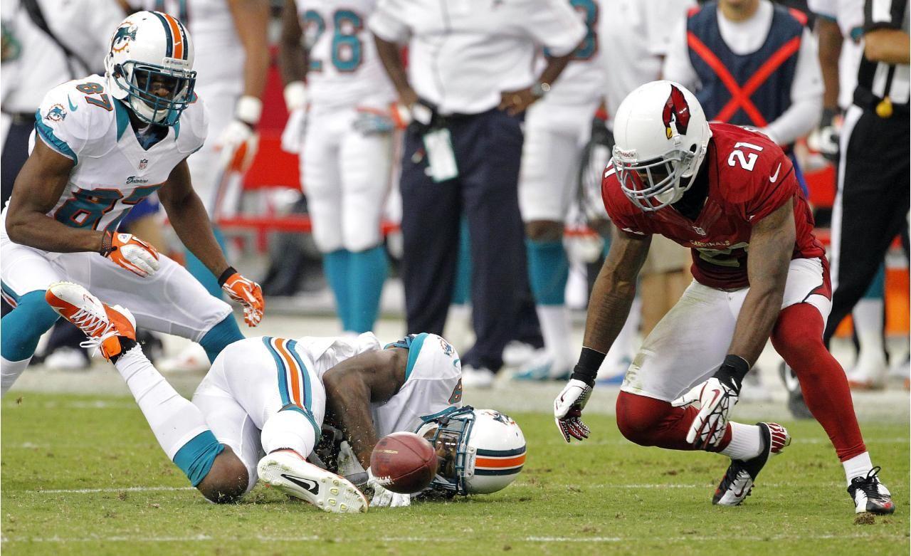 Arizona Cardinals Cornerback Patrick Peterson Picks Up A Fumble By Miami Dolphins Wide Receiver Legedu Naanee Week 4 201 Cardinals Football Football Cardinals