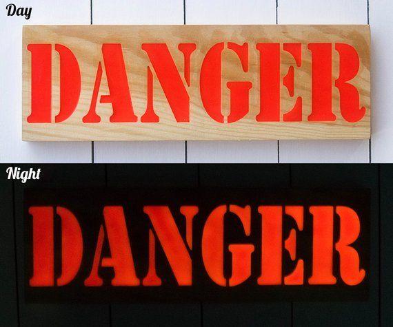 Glow in the dark sign, night glow, danger sign, warning sign