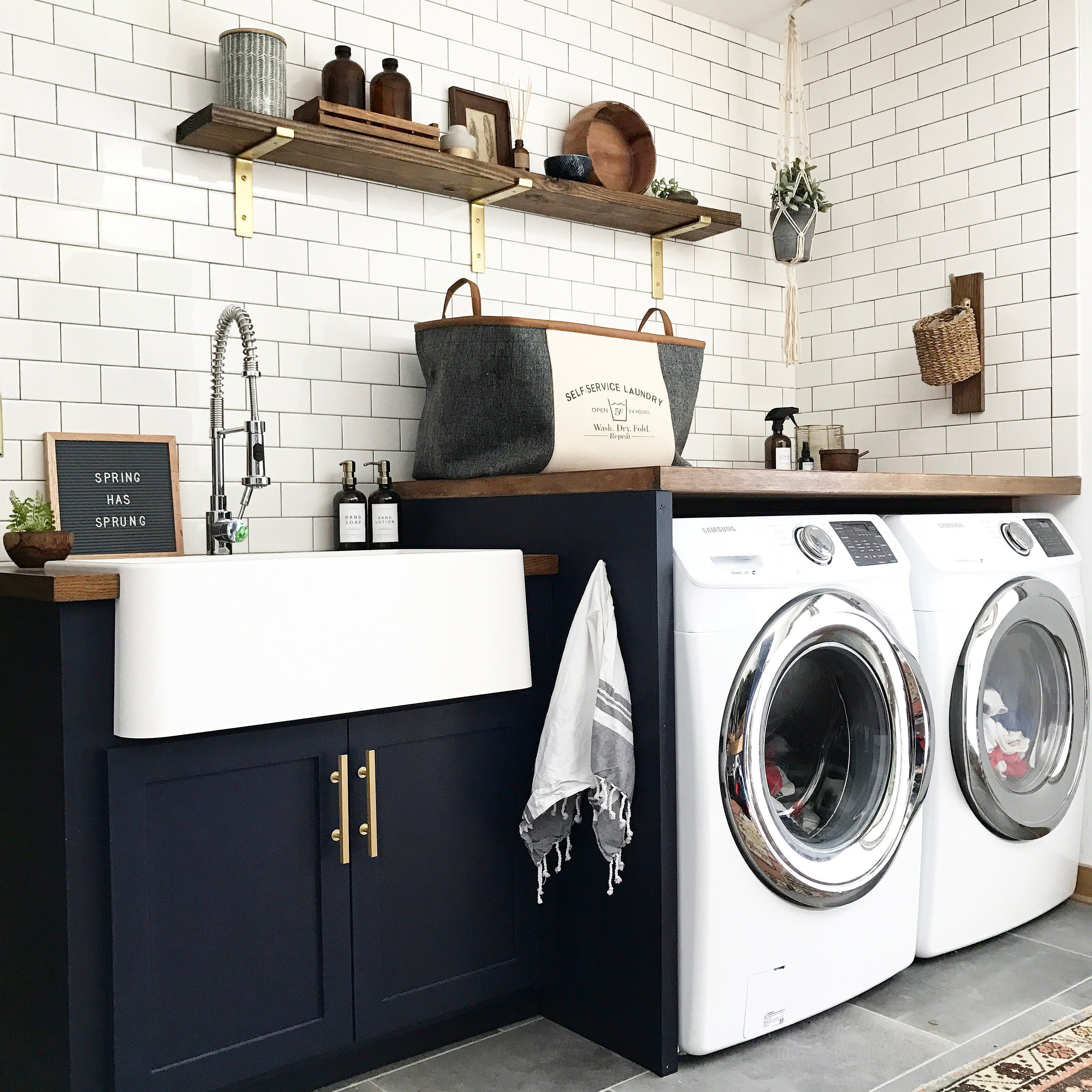 Navy Cabinets Gold Hardware And Bracketsm Wood Shelves And