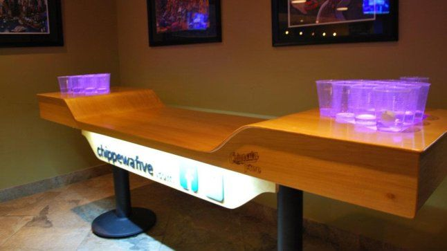 Beer pong tables with automatic ball washers and friggin moats