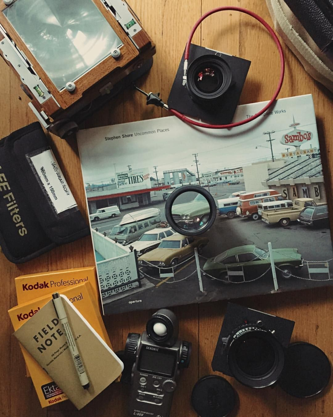 tapanddye:  Sunday essentials. Some pre-shoot reading/inspiration with a classic piece of large format goodness. #legacyshooters
