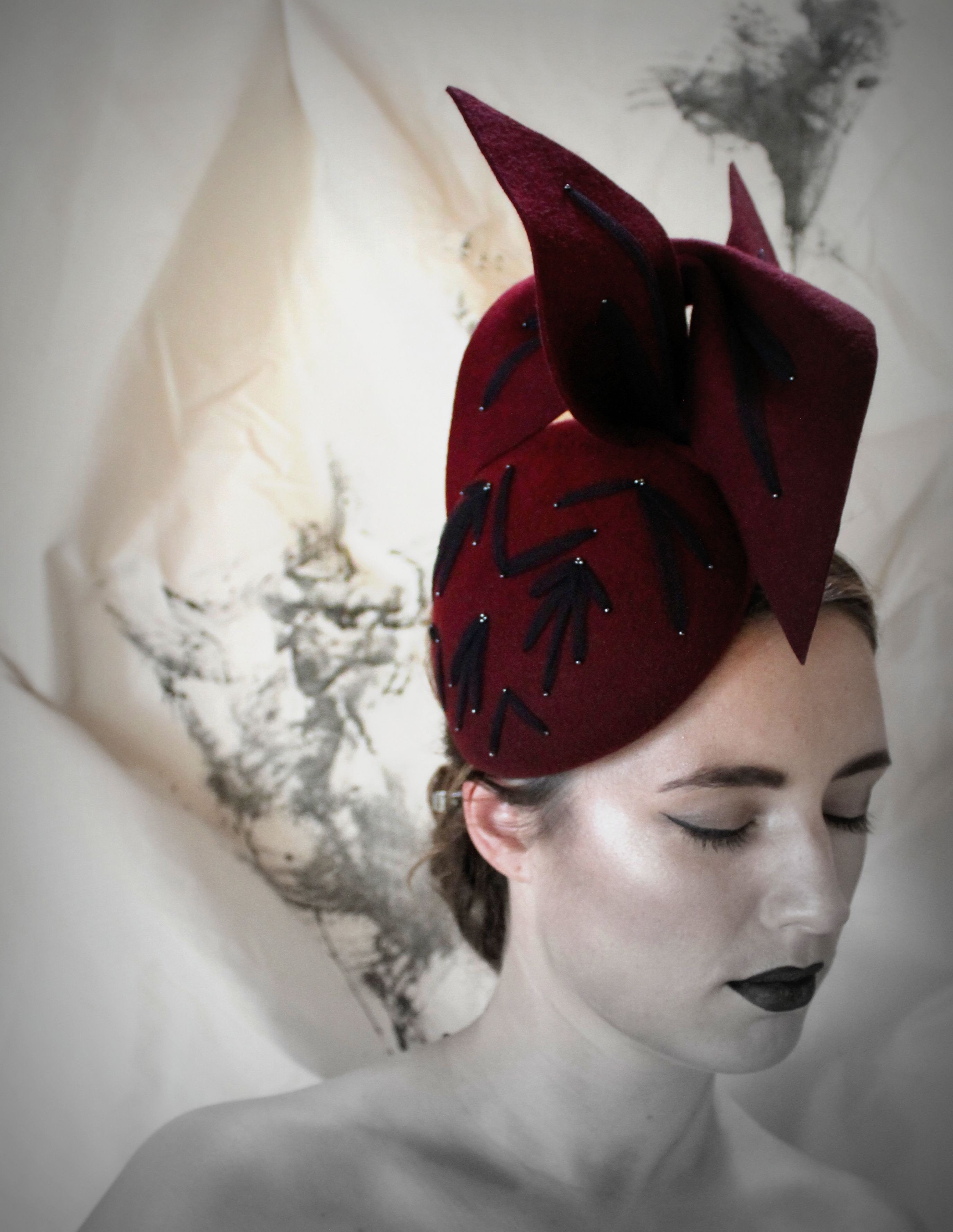 A real showstopper of a hat for race days or a winter wedding. Irish  millinery at LGM Hats b63be2f476f