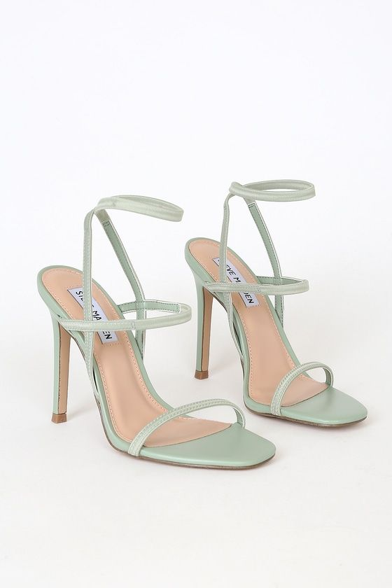 Slip on the Steve Madden Nectur Mint High Heel Sandals for an instant confidence boost! A slender toe band tops a strappy vamp and matching ankle strap, all shaped by comfortable stretchy elastic straps! Pair with an LBD and sunnies for a classic, sexy look! Fit: This garment fits true to size. 4. 25