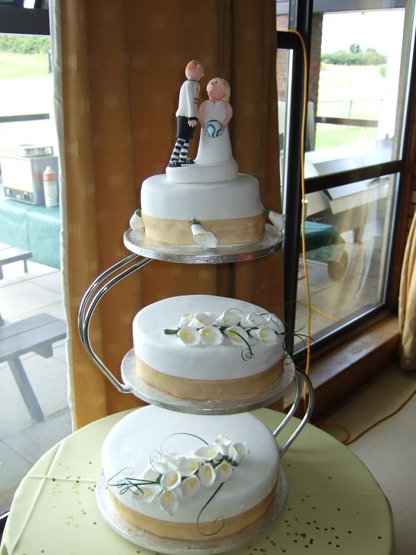 wedding cake 3 separate tiers tier cake on a s shaped stand with and groom 21696