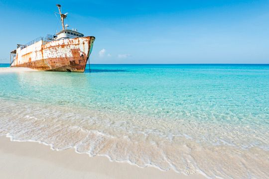 The Mega One Triton - This large vessel greets all visitors to Governor's Beach on Grand Turk. Washed ashore during Hurricane Sandy in 2012, efforts to remove the ship have been unsuccessful as of yet. #VisitTCI