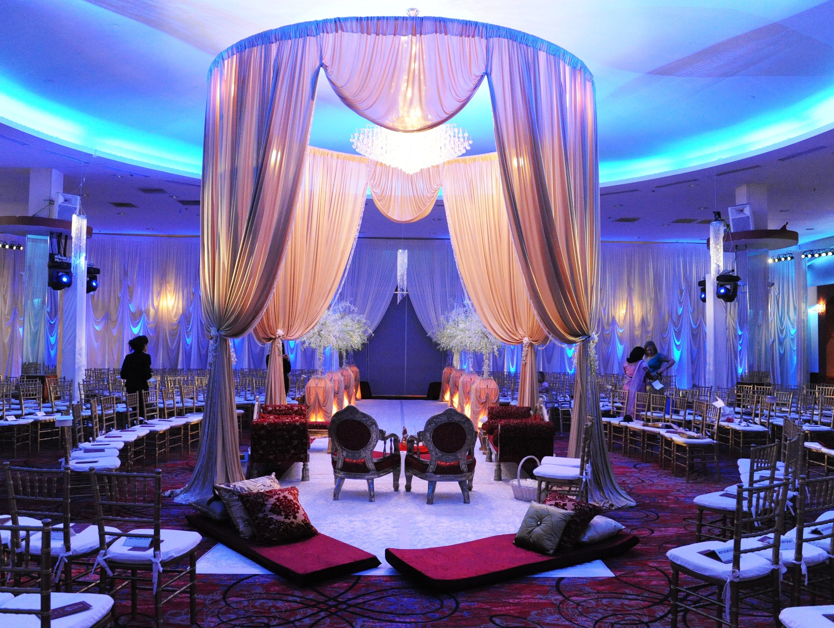 Wedding flowers and decorations indian wedding ceremony light elegant indian wedding ceremony with a gold mandap up lit with blue led up lighting junglespirit Images