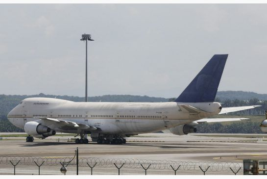 One of three apparently abandoned Boeing 747-200F planes parked at Kuala Lumpur International Airport in Sepang, Malaysia. A new air cargo operator says the aircraft belong to them.