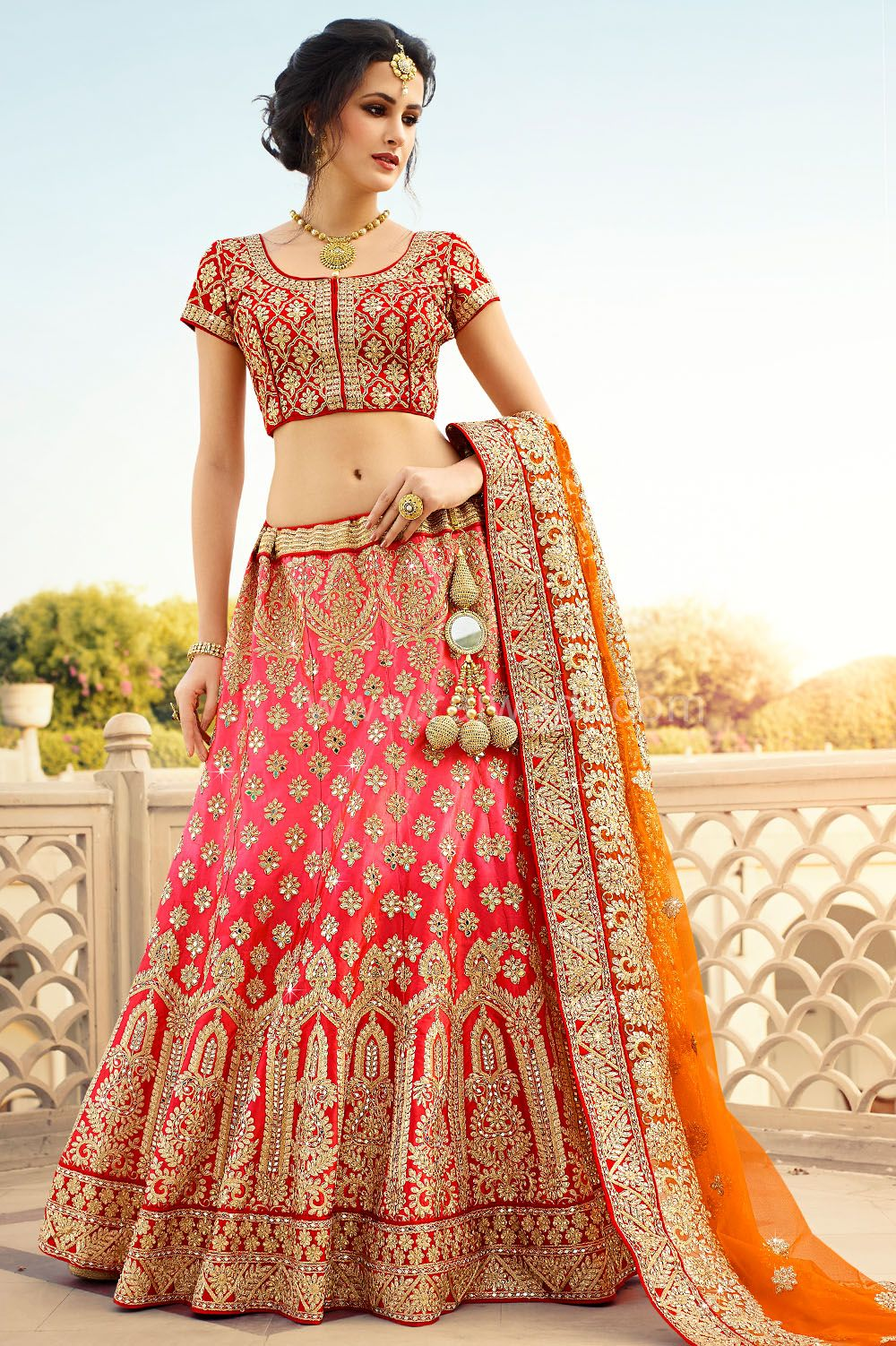 3ca126ee52 Bridal Wear Red and Orange coloured Lehenga Choli #RajwadiLehengas #Lehengas  #BridalLehengas #Red #Orange #FeelRoyal