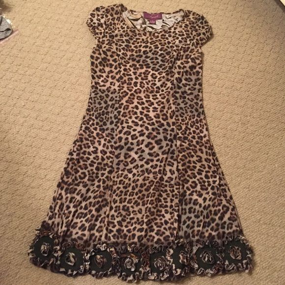 NWOT Argenti Leopard Ruffle Bottom Dress!! NWOT Argenti Leopard Ruffle Bottom Dress!! Size: 8!! Never been worn, in perfect condition!! This dress is SO cute, I LOVE it!!!!!! 96% polyester and 4% spandex!! Machine washable!!❤️❤️ Argenti Dresses Midi