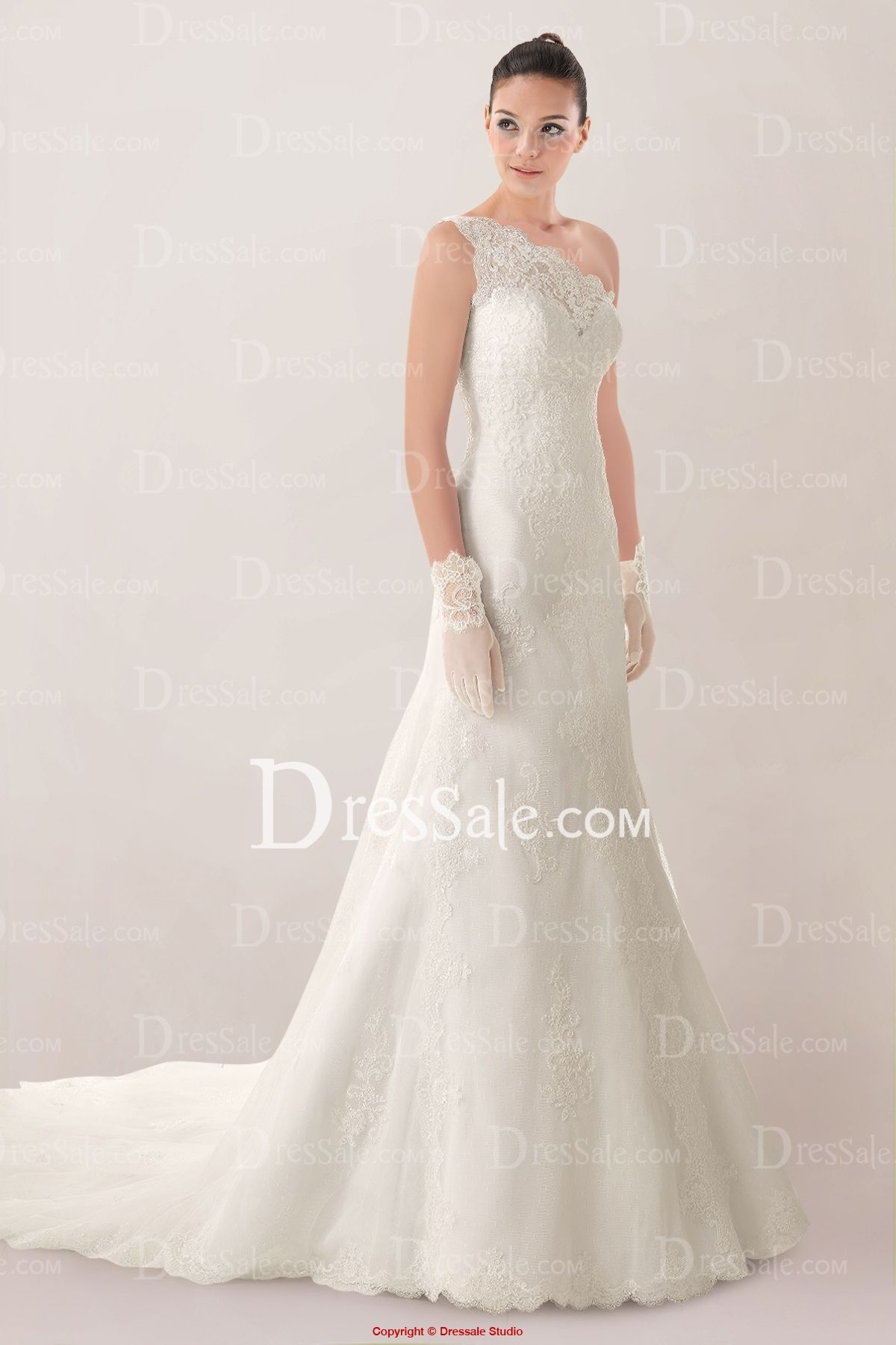 Glamorous oneshoulder aline wedding dress featuring lace overlay