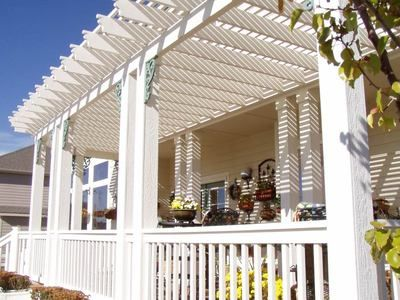 White painted cedar pergola outside project pinterest pergolas cedar pergola and balconies - Houses with covered balconies ...