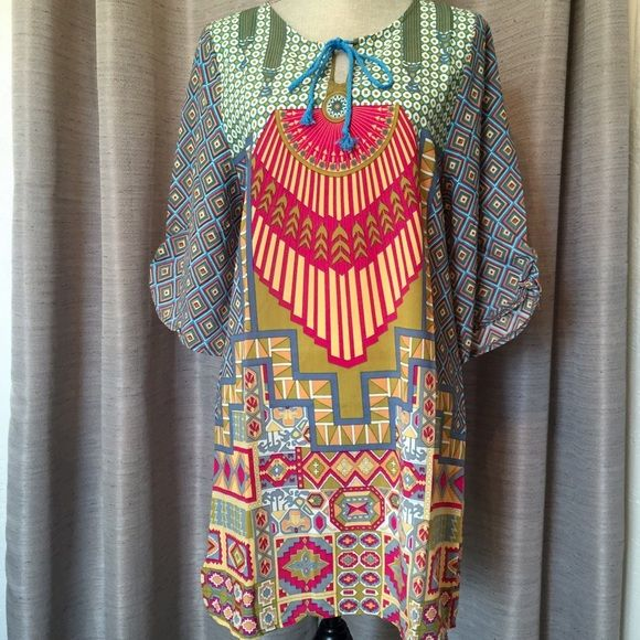"Boho shift dress •ITS HERE!!•  Shoulder 15.2"" Sleeve 16"" Bust 37.4"" Waist 40"" Hip 40"" Length 33""  Gorgeous, bold and fun Aztec tribal print shift dress Boutique Dresses"