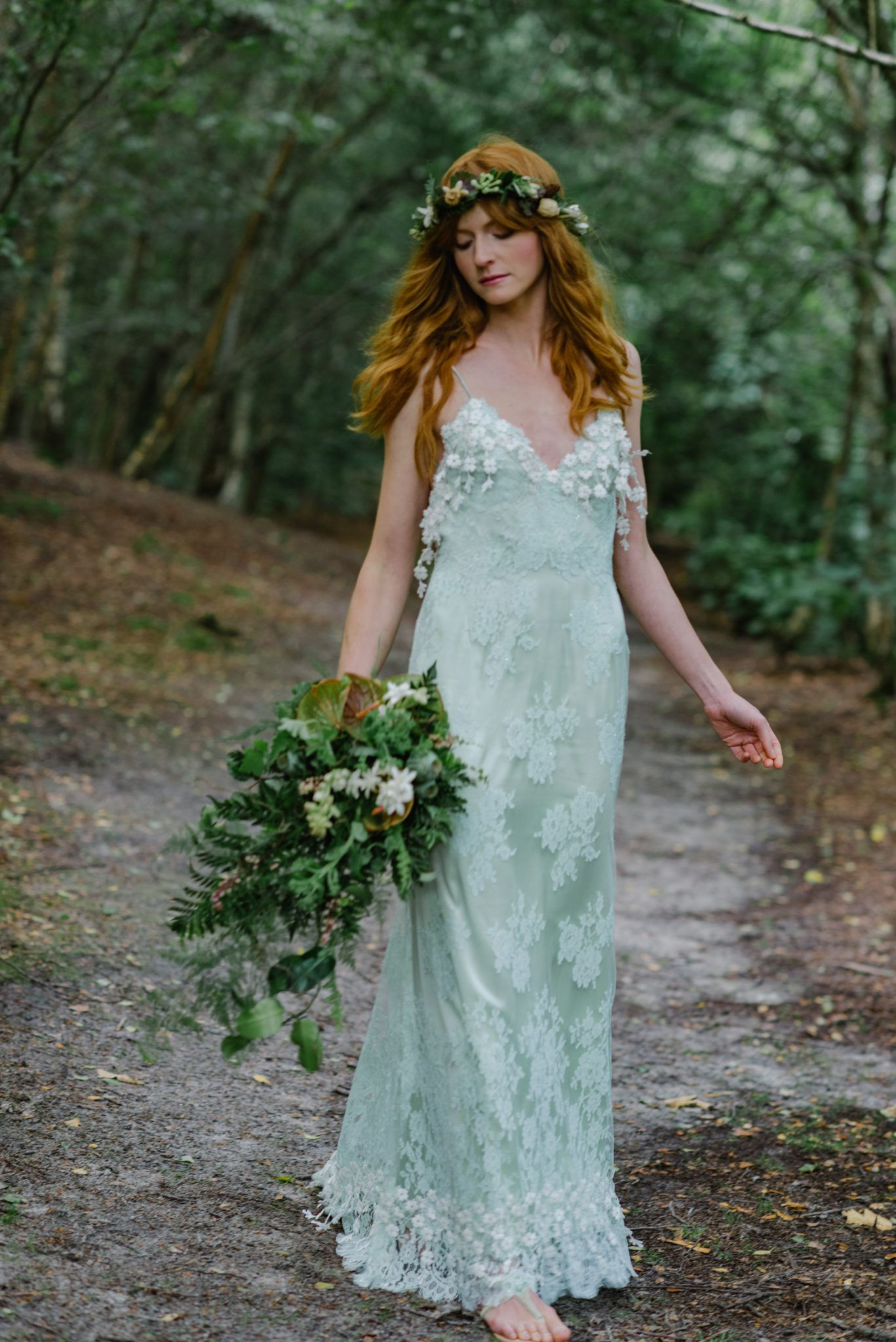 Green wedding dress in bohemian lace for a woodland styled shoot