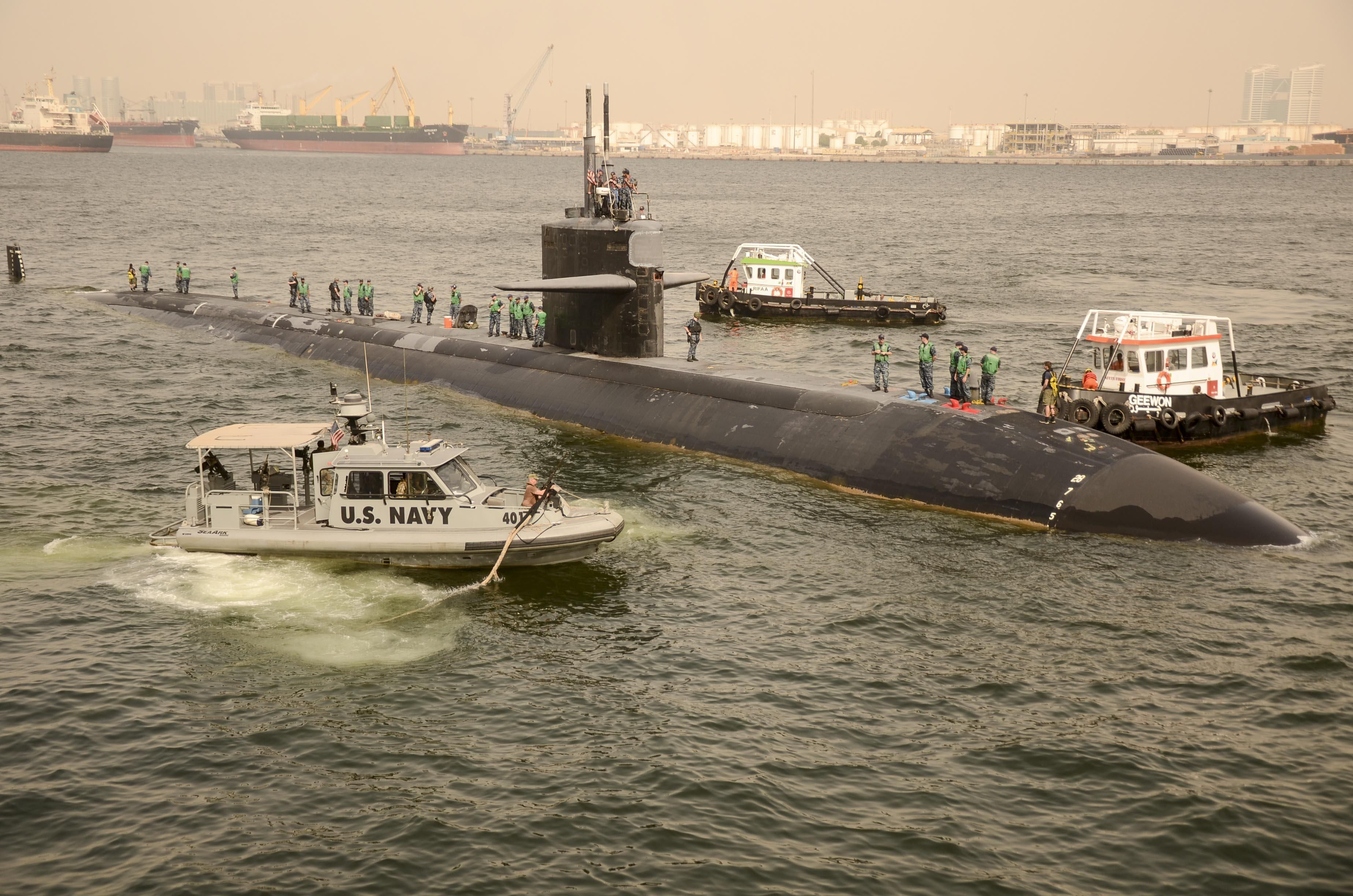 SUB ~ USS Dallas (SSN-700) is escorted to pull alongside the submarine tender USS Frank Cable (AS-40) while pulling into port. Jebel Ali, United Arab Emerites. Aug. 2016. ~ BFD