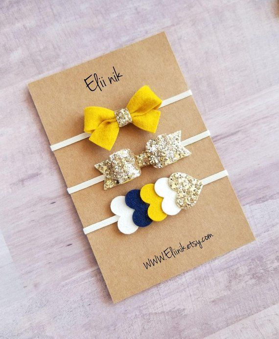 Gold Glitter bow headband set, bow measure approximately 21/4 long 3/4 attached to a skinny elastic headband. mustard tie
