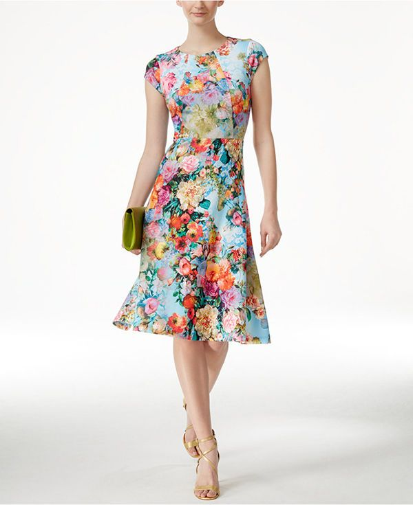 Garden Glamour: Spring means fresh flowers in bloom. Reflect the season with a celebratory floral-patterned dress in a cute silhouette complete with tiny cap sleeves for an engagement party.