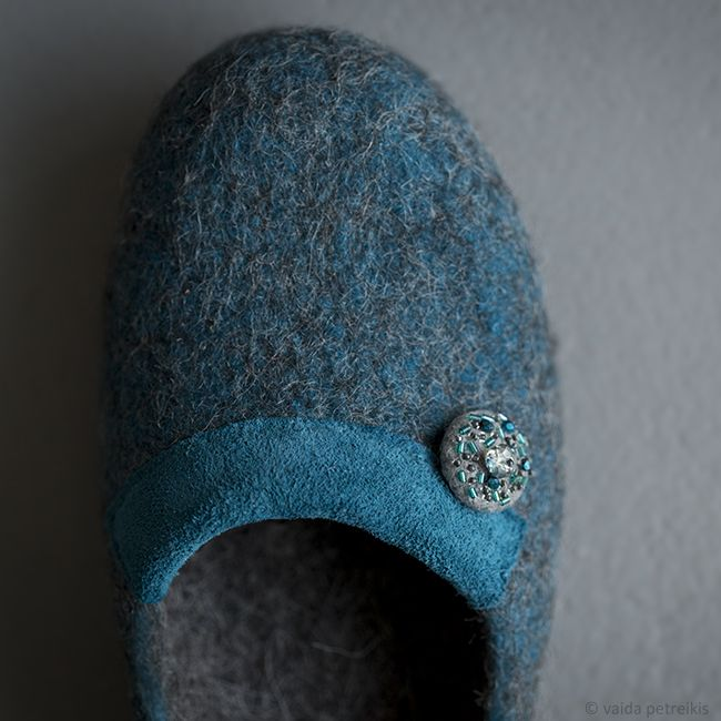 100 % handmade pure natural wool felted slippers with natural leather and original decoration made of grey handmade felt covered button with seed beads and crystals. Limited edition. Made by Felt Studio VART