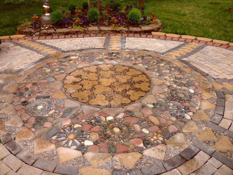 Beautiful garden mosaic patio made with pavers with step for Mosaic garden designs