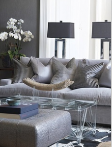 Monochromatic Grey Living Room With Paired Black Lamp Shades And Striped Toss Cushions
