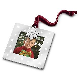 Take away the snowflake, I like the idea of frames as favors. Get a Polaroid picture taken and put it in there :)