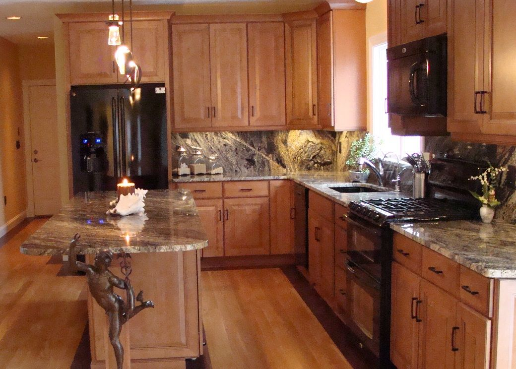 Kitchen With Black Appliances, Glazed Maple Cabinets, Gray Marble  Countertopsu2026