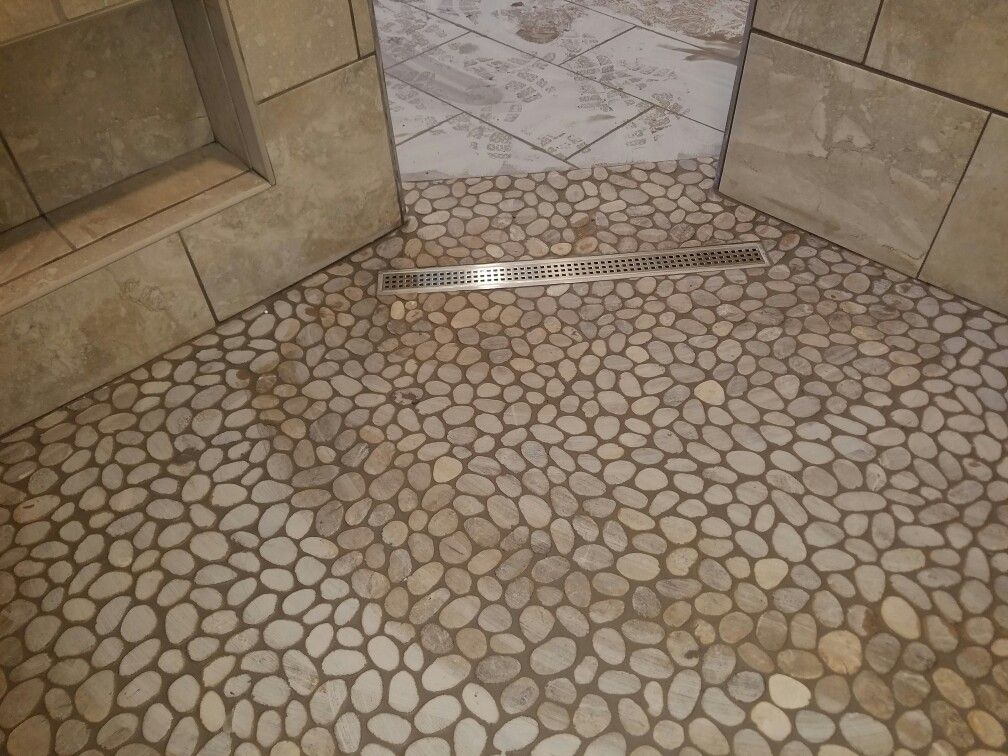 Smoothed Pebble Rock Shower Floor With A Linear Drain Shower Floor Shower Tile Pebble Tile Shower