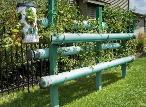 fantastic PVC vertical planter idea for strawberries or whatever ...