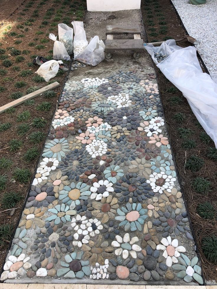 Photo of Is this the sweetest thing ever? #stone #Mosaic #pebbles #walkway #path #diy