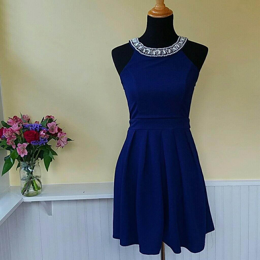 Blue jeweled neck dress products
