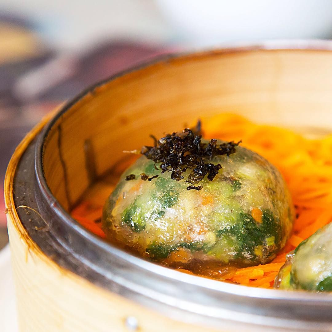 Steamed spinach & Chinese celery dumplings with mushrooms, jicama and preserved olive vegetable.