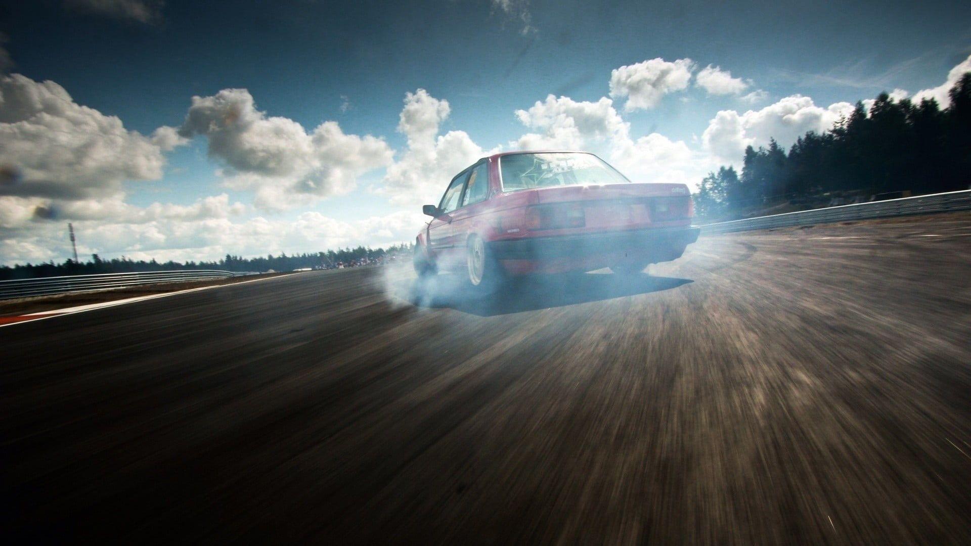 Red Car Drift Smoke Car Clouds Sky Race Tracks Bmw E30 Vehicle 1080p Wallpaper Hdwallpaper Desktop In 2021 Bmw E30 Red Car E30 Drift