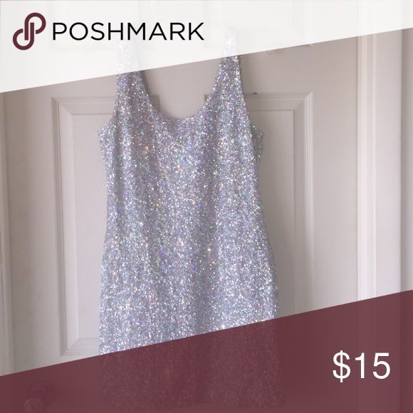 Sleeveless sliver sparkly dress What to shine like a diamond? Then this is the prefect dress for you. It's sleeveless and a body gripper. Defiantly made for a night out on the town Charlotte Russe Dresses Mini