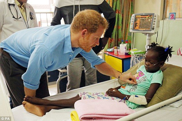 Back again:On Harry's first visit to the hospital six years ago he was pictured cooing ov...