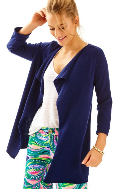 A cashmere cardigan is a must-have this season, and the Oleander Cashmere Cardigan is the perfect way to fill that space in your closet. This elbow sleeve open cardigan has a slightly turned back collar and rolled up cuffs, and is a great layering piece over your printed shirts, tanks, and dresses.