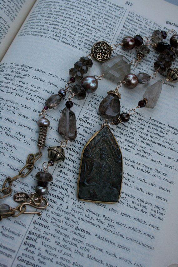 Buddha amulet and gemstone necklace