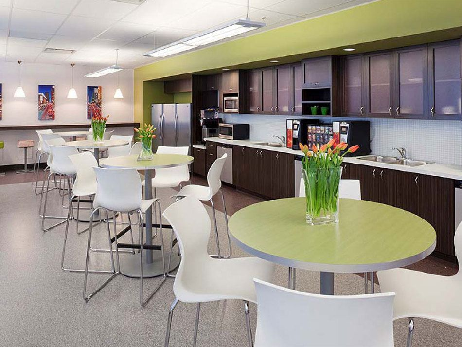Proof that corporate design can be cool design for Office lunch room design ideas