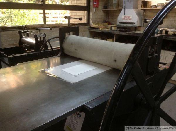 intaglio plate and paper on press wm